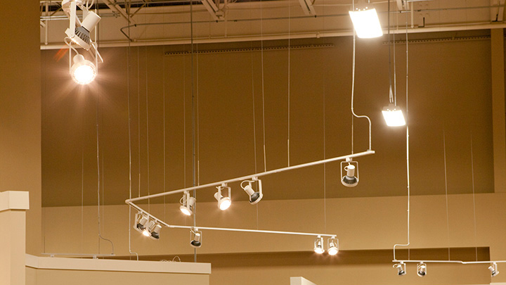 Ashley Furniture HomeStore lit with Track heads using LED Lamps