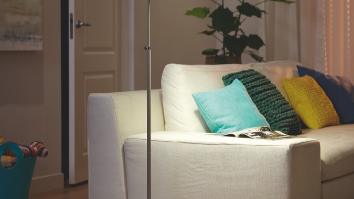 Floor lamp lighting a couch