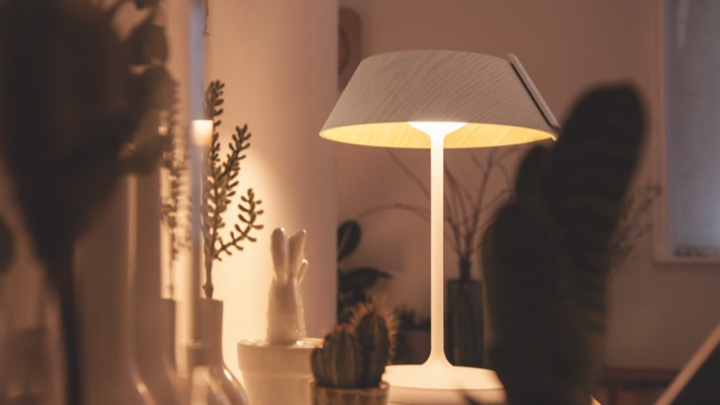 Table lamp lighting a living room cabinet