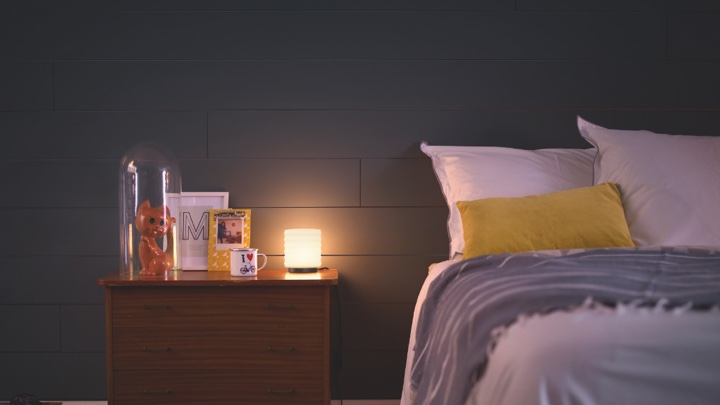 A warm glowing light on a night stand